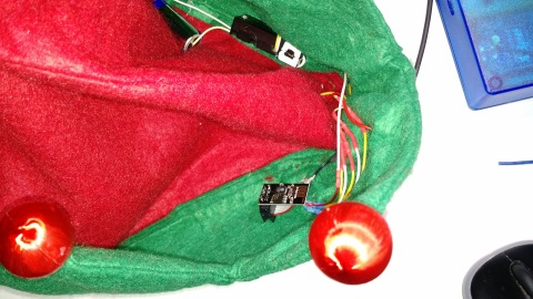 ESP-01 wired to existing lights in the ornaments on the Elf hat